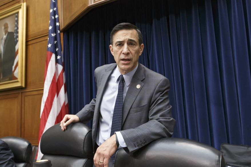 House Oversight Committee Chairman Rep. Darrell Issa, R-Calif., arrives for a hearing on Capitol Hill in Washington, Thursday, Jan. 16, 2014,  investigating the chaotic rollout of the HealthCare.gov website. (AP Photo/J. Scott Applewhite)