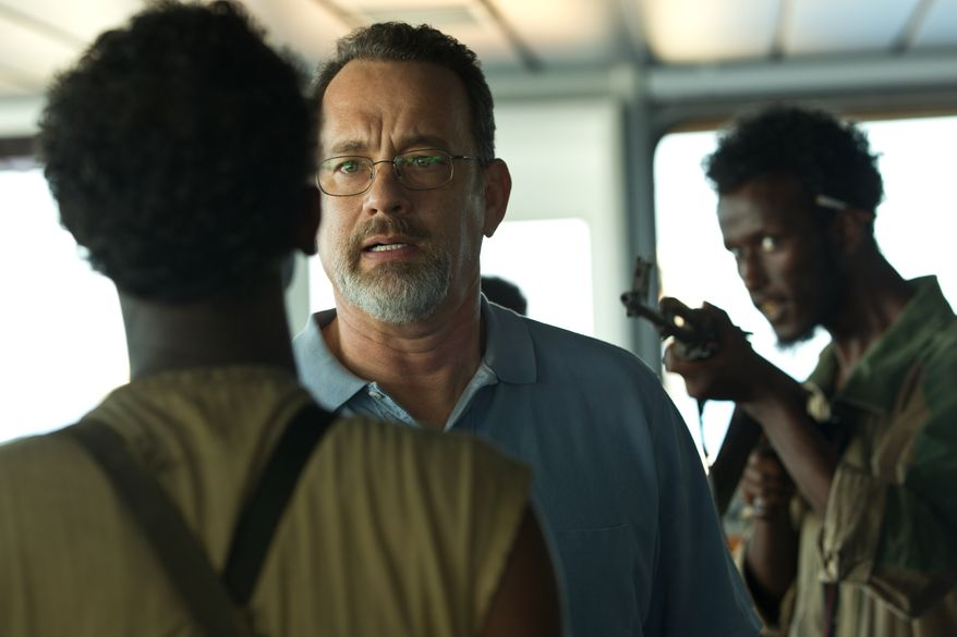 "Tom Hanks, center, in a scene from ""Captain Phillips.""  The film was nominated for an Academy Award for best picture on Thursday, Jan. 16, 2014, but no Best Actor nomination for Hanks. (AP Photo/Sony - Columbia Pictures)"