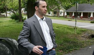 FILE - In this Tuesday April 23, 2013, file photo, James Everett Dutschke stands in the street near his home in Tupelo, Miss. A change-of-plea hearing is scheduled for Dutschke  a man charged with sending poison-laced letters to President Barack Obama and other officials. James Everett Dutschke is scheduled for a hearing in U.S. District Court in Oxford on Friday afternoon, Jan. 17, 2014 according to court documents. (AP Photo/Northeast Mississippi Daily Journal, Thomas Wells, File) MANDATORY CREDIT