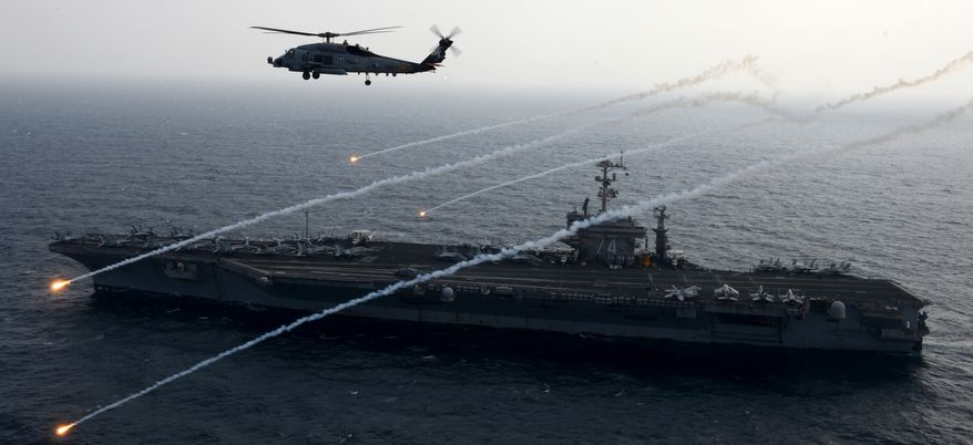 U.S. 5TH FLEET AREA OF RESPONSIBILITY (Feb. 15, 2013) An MH-60R Sea Hawk from the Raptors of Helicopter Maritime Strike Squadron (HSM) 71 launches flares alongside the aircraft carrier USS John C. Stennis (CVN 74). John C. Stennis is deployed to the U.S. 5th Fleet area of responsibility conducting maritime security operations, theater security cooperation efforts and support missions for Operation Enduring Freedom. (U.S. Navy photo by Mass Communication Specialist 2nd Class Kenneth Abbate/Released) 130215-N-OY799-074  Join the conversation http://www.facebook.com/USNavy http://www.twitter.com/USNavy http://navylive.dodlive.mil
