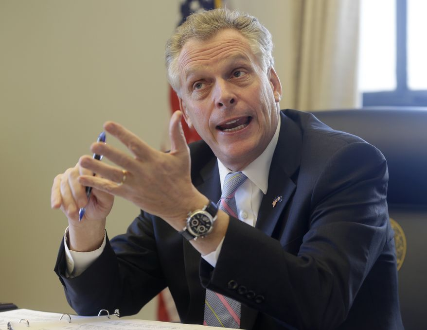 Virginia Gov. Terry McAuliffe gestures during an interview in his office at the Capitol in Richmond, Va., Friday, Jan. 17, 2014. McAuliffe, appointed former republican operative Boyd Marcus to the Virginia ABC Board.  (AP Photo/Steve Helber)
