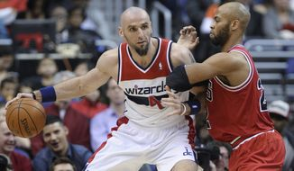 Washington Wizards center Marcin Gortat (4) keeps the ball from Chicago Bulls forward Taj Gibson during the second quarter of an NBA basketball game in Washington, Friday, Jan. 17, 2014. The Wizards won 96-93. (AP Photo/Susan Walsh)