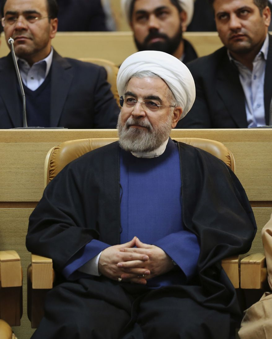Iranian President Hassan Rouhani sits at the 27th International Islamic Unity Conference in Tehran, Iran, Friday, Jan. 17, 2014. (AP Photo/Vahid Salemi)
