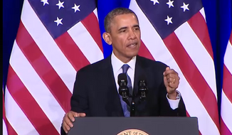 President Obama speaks at Justice Department headquarters in D.C. on Friday.
