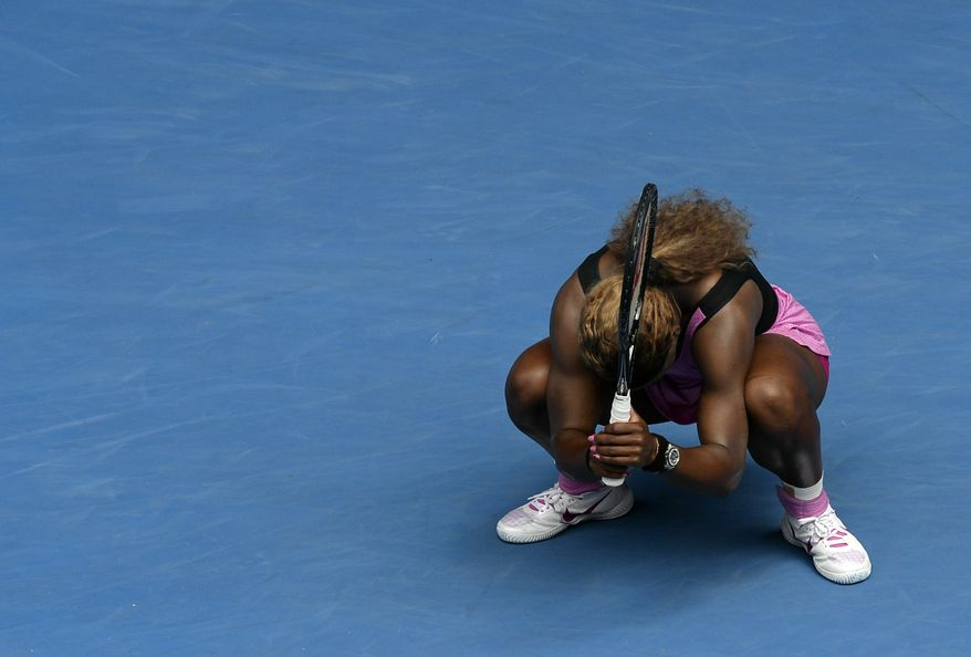 Serena Williams of the U.S. reacts after losing a point to  Ana Ivanovic of Serbia during their fourth round match at the Australian Open tennis championship in Melbourne, Australia, Sunday, Jan. 19, 2014.(AP Photo/Andrew Brownbill)