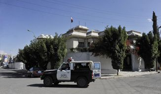 "A Yemeni police vehicle patrols outside of the Iranian ambassador's residence in Sanaa, Yemen, Saturday, Jan. 18, 2014. Iranian state television announced that Ali Asghar Asadi, Iran's economic attache in Sanaa, was ""martyred."" (AP Photo/Hani Mohammed)"