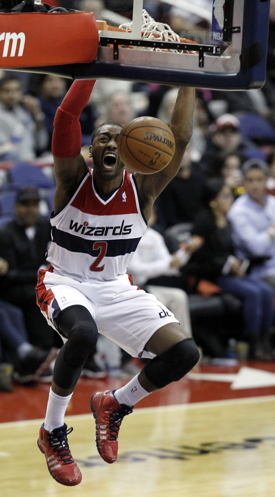 Washington Wizards guard John Wall reacts as he dunks the ball in the second half of an NBA basketball game against the Detroit Pistons, Saturday, Jan. 18, 2014, in Washington. Wall had 34 points, but the Pistons won 104-98. (AP Photo/Alex Brandon)