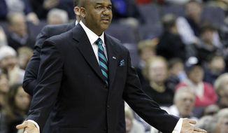 Georgetown head coach John Thompson III reacts during the first half of an NCAA college basketball game against Seton Hall, Saturday, Jan. 18, 2014, in Washington. Seton Hall won 67-57. (AP Photo/Alex Brandon)