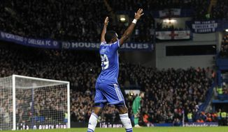 Chelsea's Samuel Eto'o celebrates after scoring his 3rd goal against Manchester United's during their English Premier League soccer match at Stamford Bridge, London, Sunday, Jan. 19, 2014. (AP Photo/Sang Tan)