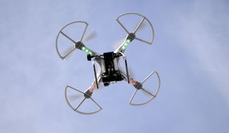 When the FAA finishes its new drone regulations, we hope they won't apply to pint-sized models from the toy store. (AP Photo/The Berkshire Eagle, Ben Garver, File)