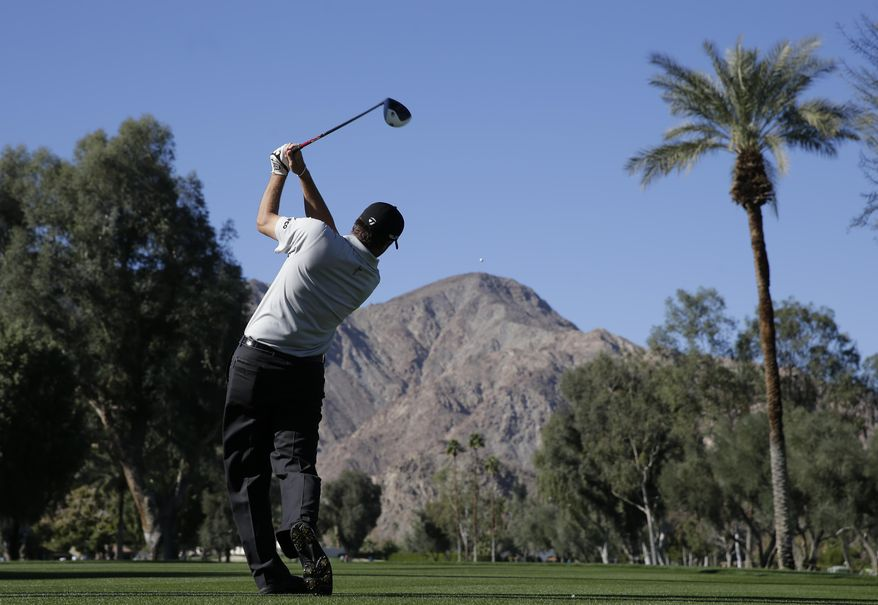 Ryan Palmer watches his tee shot on the 17th hole during the second round of the Humana Challenge golf tournament at La Quinta Country Club on Friday, Jan. 17, 2014, in La Quinta, Calif. (AP Photo/Chris Carlson)