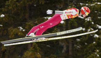 Germany's Eric Frenzel soars through the air during the ski jumping portion on day one of the Nordic Combined triple World Cup in Seefeld, Austria, Friday, Jan. 17, 2014. (AP Photo/Michael Probst)