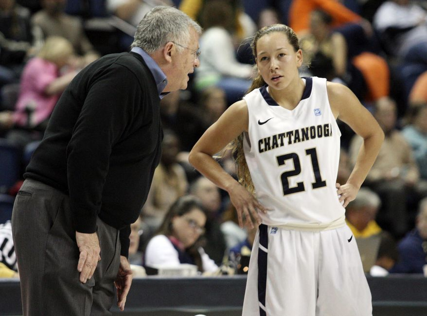 In this Nov. 24, 2013 photo, Chattanooga head coach Jim Foster talks with guard Alex Black (21) during an NCAA college basketball game in Chattanooga, Tenn. Chattanooga may not be nationally recognized as a women's college basketball power, but its 32-game home winning streak is the longest in the game, and includes wins over Southeastern Conference programs Tennessee, Auburn and Alabama. (AP Photo/, Chattanooga Times Free Press, C. B. Schmelter) THE DAILY CITIZEN OUT; NOOGA.COM OUT; CLEVELAND DAILY BANNER OUT; LOCAL INTERNET OUT