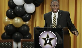 Derek Mason addresses the media as he is introduced as the new Vanderbilt football coach during an NCAA college football news conference Saturday, Jan. 18, 2014, in Nashville, Tenn. Mason was previously the defensive coordinator at Stanford. (AP Photo/Mark Humphrey)