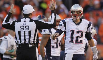 New England Patriots quarterback Tom Brady (12) reacts to a call by referee Tony Corrente during the second half of the AFC Championship NFL playoff football game against the Denver Broncos in Denver, Sunday, Jan. 19, 2014. (AP Photo/Joe Mahoney)
