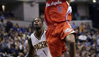 Los Angeles Clippers guard Jamal Crawford (11) shots in front of Indiana Pacers guard Lance Stephenson (1) during the first half of an NBA basketball game in Indianapolis, Saturday, Jan. 18, 2014. (AP Photo/AJ Mast)