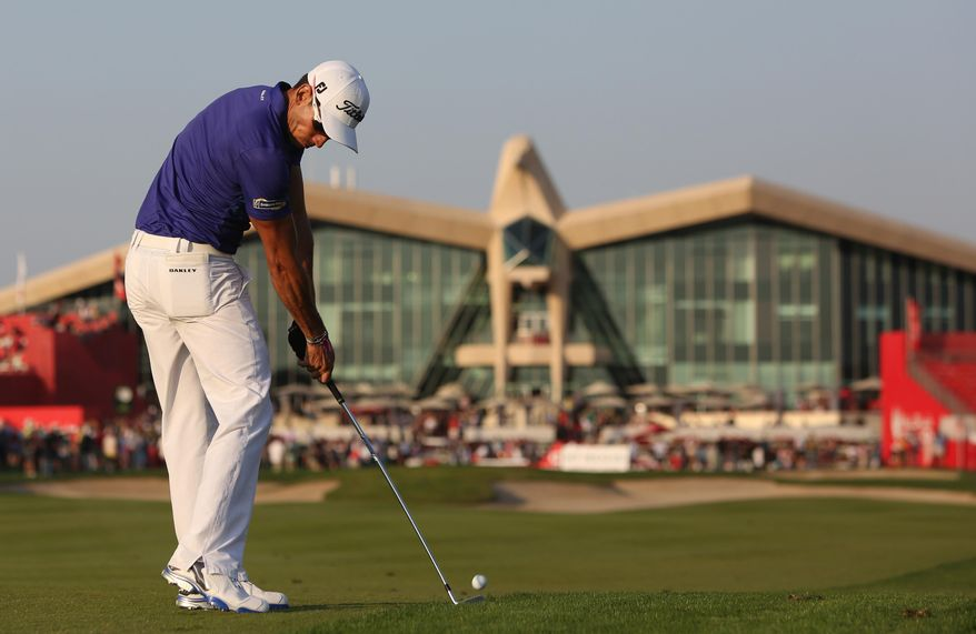 Rafa Cabrera-Bello of Spain plays a ball on the 9th hole during the 2nd round of the Abu Dhabi HSBC Golf Championship in Abu Dhabi, United Arab Emirates, Friday, Jan. 17, 2014. (AP Photo/Kamran Jebreili)