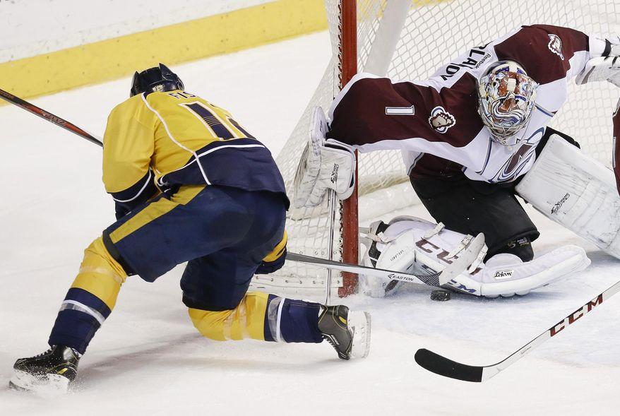 Colorado Avalanche goalie Semyon Varlamov (1), of Russia, blocks a shot by Nashville Predators forward Mike Fisher (12) in the second period of an NHL hockey game, Saturday, Jan. 18, 2014, in Nashville, Tenn. (AP Photo/Mark Humphrey)