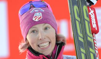 Kikkan Randall from the U.S. poses for photographers after the decoration following her win in the Ladies World Cup Cross Country Ski 1.5km Sprint Free event in Szklarska Poreba, Poland, Saturday, Jan. 18, 2014. (AP Photo/Alik Keplicz)