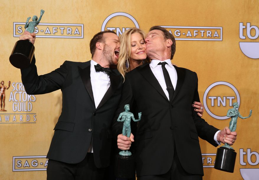 "From left, Aaron Paul, Anna Gunn and Bryan Cranston pose in the press room with their awards for outstanding performance by an ensemble in a drama series for ""Breaking Bad"" at the 20th annual Screen Actors Guild Awards at the Shrine Auditorium on Saturday, Jan. 18, 2014, in Los Angeles. (Photo by Matt Sayles/Invision/AP)"