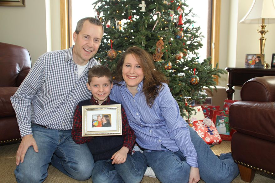 This December 2012 photo provided by the family shows, from left, John, Jack and Renee Thomas at their home in Minnetrista, Minn. Jack was adopted from Russia in 2008. At the time the Russian ban on adoptions by Americans was imposed in 2013, the family was trying to adopt Jack's biological brother, Nikolai. (AP Photo/Ron Ruud)