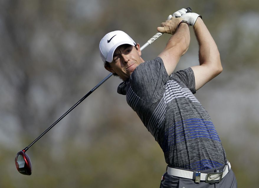 Rory McIlroy of Northern Ireland tees off on the 11th hole during the 3rd round of the Abu Dhabi HSBC Golf Championship in Abu Dhabi, United Arab Emirates, Saturday Jan. 18, 2014. (AP Photo/Kamran Jebreili)