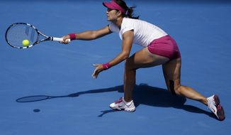Li Na of China hits a forehand return to Ekaterina Makarova of Russia during their fourth round match at the Australian Open tennis championship in Melbourne, Australia, Sunday, Jan. 19, 2014. (AP Photo/Aijaz Rahi)