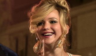 "This film image released by Sony Pictures shows Jennifer Lawrence in a scene from ""American Hustle.""  Lawrence was nominated for an Academy Award for best supporting actress on Thursday, Jan. 16, 2014, for her role in the film. The 86th Academy Awards will be held on March 2. (AP Photo/Sony - Columbia Pictures, Francois Duhamel)"
