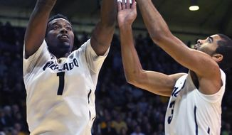 Colorado's Wesley Gordon (1) and Xavier Talton grab a rebound during the first half of an NCAA college basketball game against Southern California in Boulder, Colo., Saturday, Jan. 18, 2014. Colorado won 83-62. (AP Photo/Brennan Linsley)