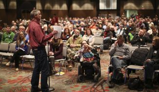 People attend a public hearing about a a proposed copper-nickel mine Thursday, Jan. 16, 2014  at the Duluth Entertainment and Convention Center in Duluth, Minn. The Jobs for Minnesotans coalition of business and union groups chartered seven buses to help bring what they promise will be more than 500 people from the Iron Range to Duluth for a show of force. Opponents hope to turn out a roughly equal crowd. (AP Photo/The Star Tribune, Jeff Wheeler)  MANDATORY CREDIT; ST. PAUL PIONEER PRESS OUT; MAGS OUT; TWIN CITIES TV OUT