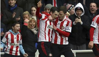 Sunderland's Adam Johnson, left, celebrates his goal with a teammate during their English Premier League soccer match against Southampton at the Stadium of Light, Sunderland, England, Saturday, Jan. 18, 2014. (AP Photo/Scott Heppell)