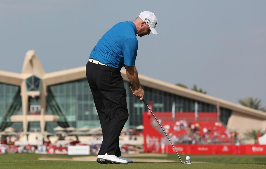Craig Lee of Scotland plays a ball on the 9th  hole during the 3rd round of the Abu Dhabi HSBC Golf Championship in Abu Dhabi, United Arab Emirates, Saturday, Jan. 18, 2014. (AP Photo/Kamran Jebreili)