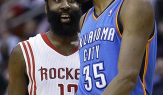 Houston Rockets' James Harden (13) talks to Oklahoma City Thunder's Kevin Durant (35) before Durant's free throws during the second quarter of an NBA basketball game Thursday, Jan. 16, 2014, in Houston. (AP Photo/David J. Phillip)