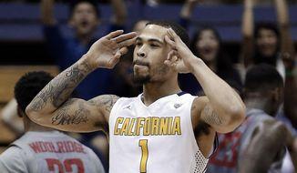 California's Justin Cobbs celebrates a score against Washington State during the first half of an NCAA college basketball game Saturday, Jan. 18, 2014, in Berkeley, Calif. (AP Photo/Ben Margot)