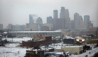 The roof of the Minnesota Vikings' Metrodome is deflated Saturday, Jan. 18, 2014 in downtown Minneapolis. The 10 acres of Teflon-coated fabric were done deflating in 35 minutes. The deflation and the demolition of the Dome beginning next week will make way for construction of a new $1 billion Vikings stadium. (AP Photo/The Star Tribune, Jim Gehrz)  MANDATORY CREDIT; ST. PAUL PIONEER PRESS OUT; MAGS OUT; TWIN CITIES TV OUT