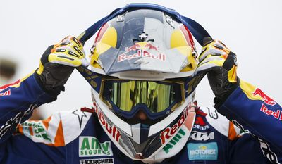 KTM rider Marc Coma, of Spain, puts on his goggles before the start of the twelfth stage of the Dakar Rally between the cities of El Salvador and La Serena, Chile, Friday, Jan. 17, 2014. (AP Photo/Victor R. Caivano)