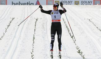 Poland's Justyna Kowalczyk celebrates as she wins the women's Cross Country skiing 10km Mass Start Classic World Cup event in Szklarska Poreba, Poland, Sunday, Jan. 19, 2014. (AP Photo/Alik Keplicz)