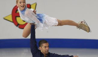 Germany's Aliona Savchenko and Robin Szolkowy perform in the pairs short program at the European Figure Skating Championships in Budapest, Hungary, Friday, Jan. 17, 2014. (AP Photo/Darko Bandic)