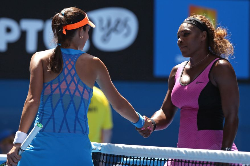 Ana Ivanovic of Serbia, left, is congratulated by Serena Williams of the U.S. after Ivanovic's fourth round win at the Australian Open tennis championship in Melbourne, Australia, Sunday, Jan. 19, 2014.(AP Photo/Aaron Favila)