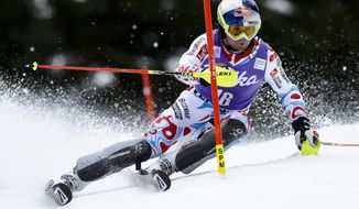 Alexis Pinturault of France clears a gate during the first run of the men's Alpine skiing slalom World Cup race at the Lauberhorn in Wengen, Switzerland, Sunday, Jan. 19, 2014. (AP Photo/Keystone, Jean-Christophe Bott)