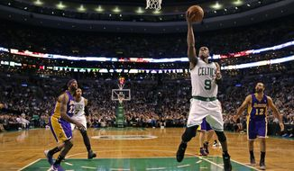 Boston Celtics guard Rajon Rondo (9) drives to the basket against the Los Angeles Lakers9during the second quarter of an NBA basketball game in Boston, Friday, Jan. 17, 2014. Rondo returned to the court for the first time this season, after undergoing surgery on his right knee. (AP Photo/Charles Krupa)