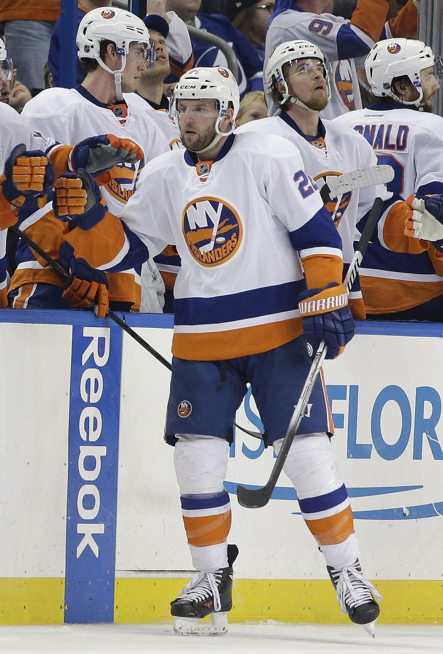 New York Islanders left wing Thomas Vanek (26), of Austria, celebrates with teammates after his goal against the Tampa Bay Lightning during the second period of an NHL hockey game, Thursday, Jan. 16, 2014, in Tampa, Fla. (AP Photo/Chris O'Meara)