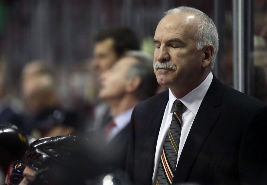 Chicago Blackhawks head coach Joel Quenneville reacts to a call during the second period of an NHL hockey game against the Boston Bruins in Chicago, Sunday, Jan. 19, 2014. (AP Photo/Nam Y. Huh)
