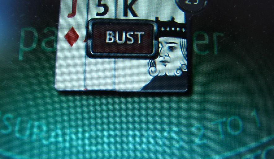 A losing game of Internet blackjack on a computer screen in Atlantic City, N.J. (AP Photo/Wayne Parry)