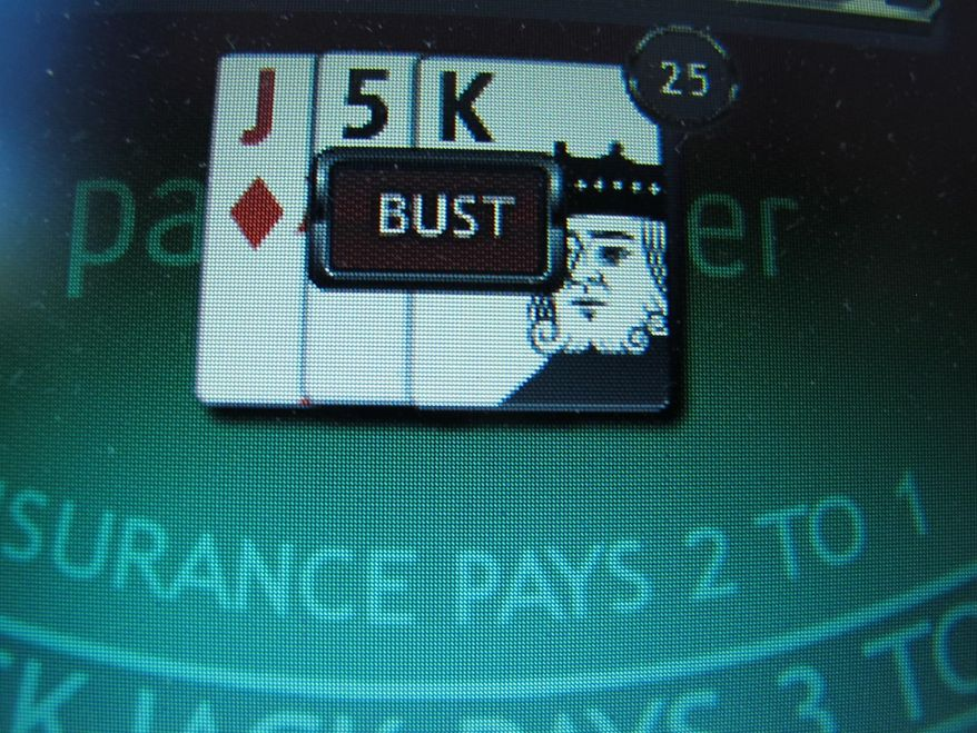 A losing game of Internet blackjack on a computer screen in Atlantic City, N.J. (AP Photo/Wayne Parry)