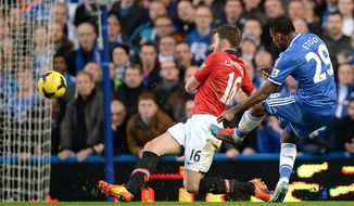 Chelsea's Samuel Eto'o, right, scores past Manchester United Michael Carick to score first goal of the game during their English Premier League soccer match at Stamford Bridge, London Sunday Jan. 19, 2014. (AP Photo/Andrew Matthews/PA) UNITED KINGDOM OUT