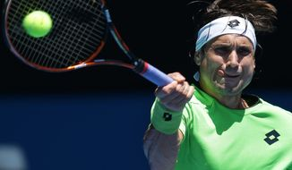 David Ferrer of Spain plays a shot to Jeremy Chardy of France  during their third round match at the Australian Open tennis championship in Melbourne, Australia, Friday, Jan. 17, 2014.(AP Photo/Aaron Favila)