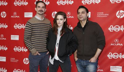 """From left, Writer and director Peter Sattler, cast member Kristen Stewart, and cast member Peyman Moaadi, pose together at the premiere of the film """"Camp X-Ray"""" during the 2014 Sundance Film Festival, on Friday, Jan. 17, 2014, in Park City, Utah. (Photo by Danny Moloshok/Invision/AP)"""