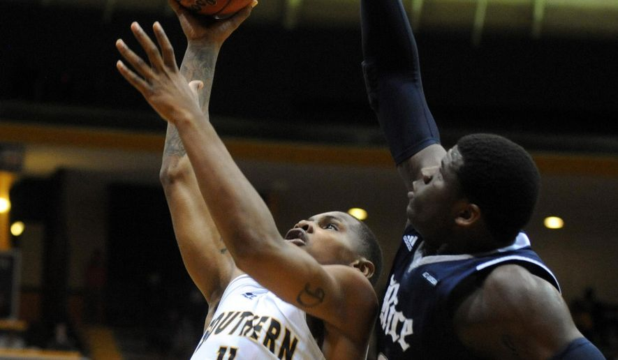 Southern Mississippi forward Daveon Boardingham, left, shoots past Rice forward Sean Obi during an NCAA college basketball game on Thursday, Jan. 16, 2014, in Hattiesburg, Miss. (AP Photo/Hattiesburg American, Ryan Moore) NO SALES **FILE**