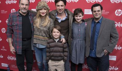 "Actor Mandy Patinkin, Actress Kate Hudson, Actor Pierce Gagnon (front), Director/Co-Writer Zach Braff, Actress Joey King and Actor Josh Gad pose at the premiere of the film ""Wish I Was Here"" during the 2014 Sundance Film Festival, on Saturday, Jan. 18, 2014 in Park City, Utah. (Photo by Arthur Mola/Invision/AP)"